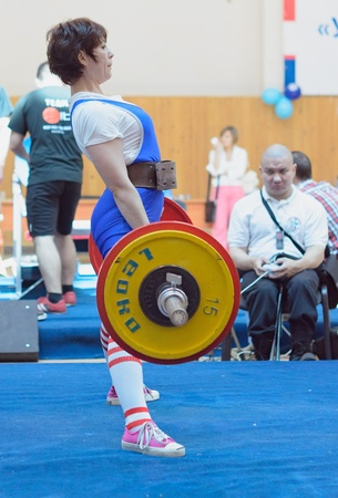 MOSCOW, RUSSIA - JUNE 13: athlete Korolevskaya Natalya in action during the Russian championship on powerlifting event in Moscow on June 13, 2013.