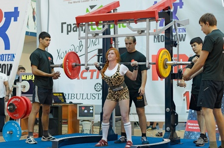 MOSCOW, RUSSIA - JUNE 13: athlete Maria Medvedeva in action during the Russian championship on powerlifting event in Moscow on June 13, 2013.