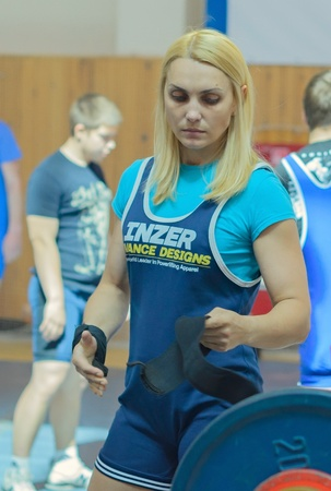 MOSCOW, RUSSIA - JUNE 13: athlete Umerenkova Julia in action during the Russian championship on powerlifting event in Moscow on June 13, 2013.