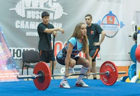 MOSCOW, RUSSIA - JUNE 13: unidentified athlete in action during the Russian championship on powerlifting event in Moscow on June 13, 2013.