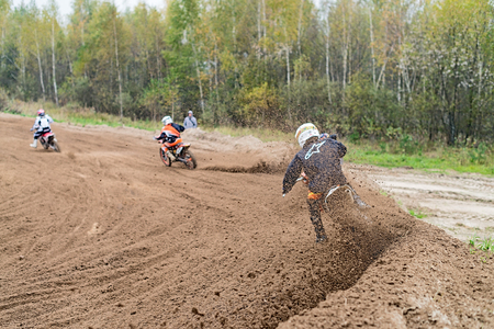 RAMENSKOYE, MOSCOW REGION, RUSSIA - OCTOBER 5: Riders in action during competition motocross in Ramenskoye on October 5, 2013. Stock Photo - 22771718
