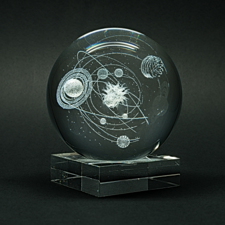 Laser engraving planets of the solar system inside the glass on a black background.