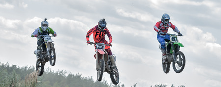 Ramenskoye, Russia - July 20, 2014: Riders pass route in action during motorcross motor club Forsazh event in Ramenskoye district, Moscow region.