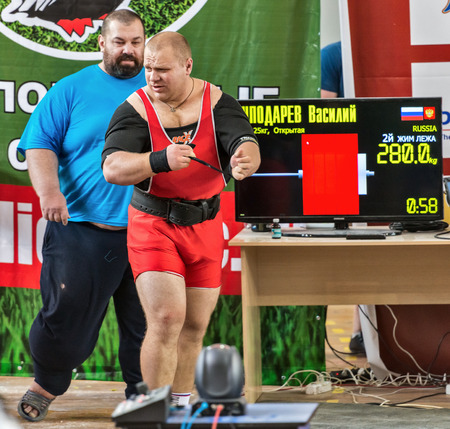 powerlifting: Moscow, Russia - August 22, 2014: Unidentified athlete in action during the 2014 world Cup powerlifting event in Moscow.