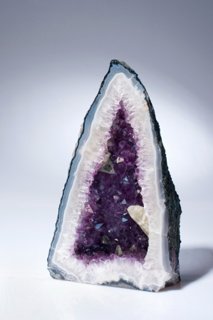 A beautiful amethyst geode also known as amethyst-grotto on a white background.