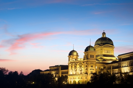 The Federal Palace of Switzerland  Bundeshaus  with red clouds, side view shot  after sunset