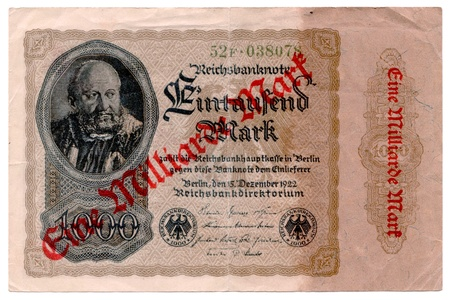denoted: Front side of a German bank note from 1922 which has been upgraded with a stamp during hyper inflation  It was denoted from 1000 Mark to 1000000000  1 Billion  Mark
