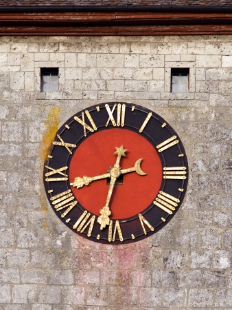 Medieval clock face on a tower with washed-out colors  photo