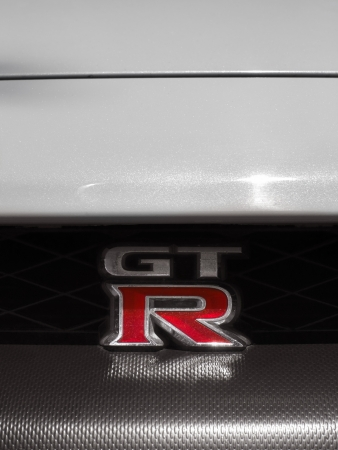 gt: Hong Kong, Hong Kong SAR, China - March 30, 2011: Close-up front view of a white parked Nissan GT-R in the streets of Kowloon.  Editorial