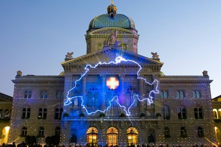 projected: Bern, Switzerland - October 14, 2011: The profile of Switzerland is projected on the Swiss government building (Bundeshaus) during the performance of the sound and light show Rendez-vous Bundesplatz.