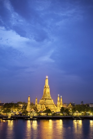 river bank: Wat Arun in Bangkok, Thailand. Shot from the opposite river bank at dusk.