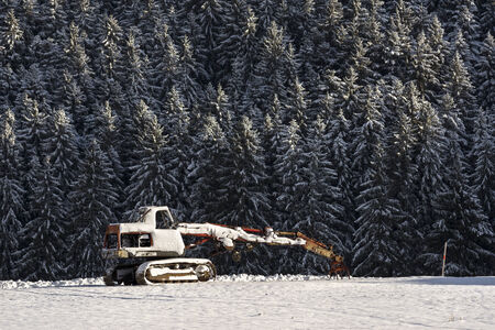 rust covered: A snow-covered  abandoned excavator  Stock Photo
