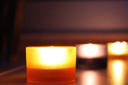 Set of relaxing atmosphere by candle lights over a dark background photo