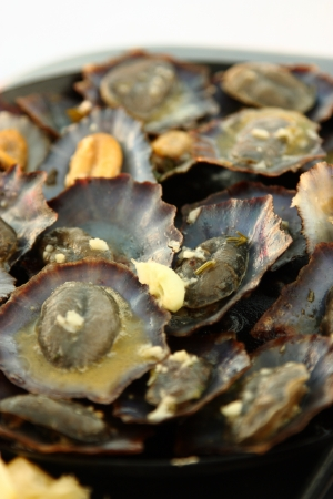Grilled limpets with lemon  Madeira s traditional dish