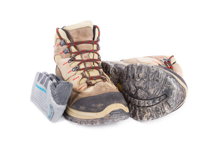 muddy clothes: Dirty hiking boots with hiking socks isolated on white background.