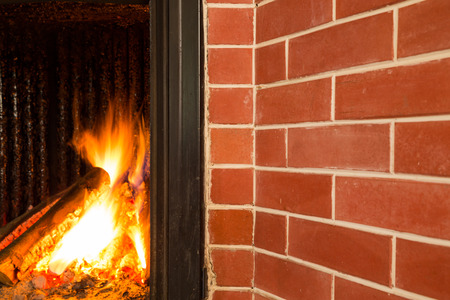 chimney corner: Fireplace, detail of home interior.
