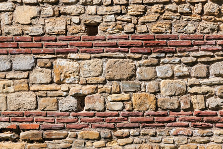 red wall: Medieval wall from ancient fortress. Stock Photo