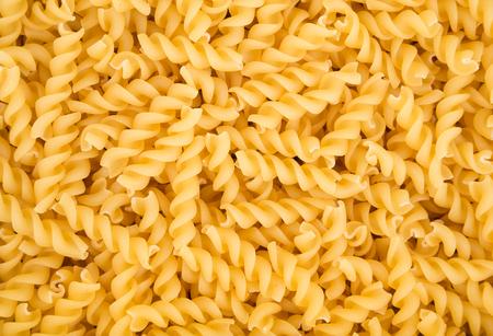 rotini: Image in close-up of raw fusilli pasta.