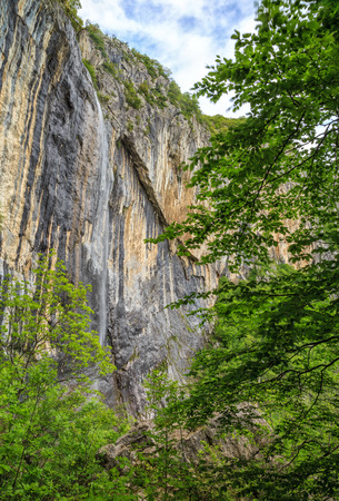 rains: Skaklya is the highest waterfall on Balkan Peninsula - 141 meters. Skaklya is intermittent flowing waterfall - only during snow melt in spring and rains. Located nearly the town of Vratsa, Bulgaria. Stock Photo