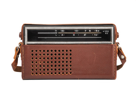 transistor: Image in close-up of an old transistor radio in a leather case isolated on white.