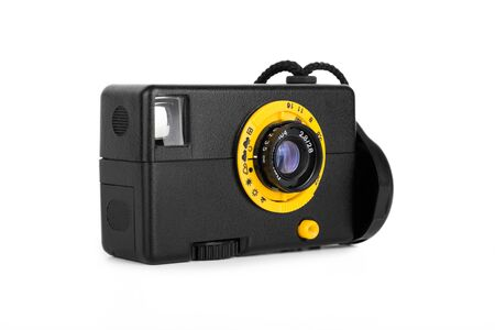 lomography: Simple plastic retro film camera. Half frame camera of dubious quality, isolated on white.