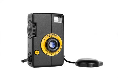 dubious: Simple plastic retro film camera. Half frame camera of dubious quality, isolated on white.