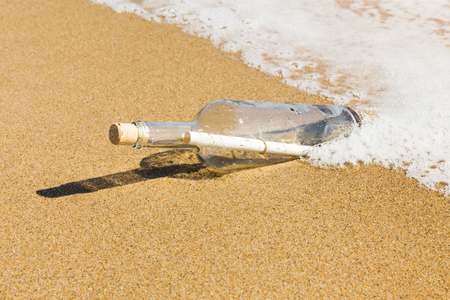 corked: Message in a bottle on the beach.