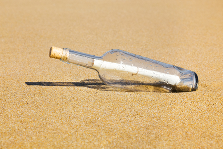 message in bottle: Message in a bottle on the beach.