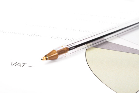 vat: Closeup of a transparent plastic ball pen on a diagram for VAT costs. Blank area for filling in VAT costs.