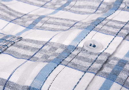 checkered polo shirt: Closeup image of striped mens shirt. Stock Photo