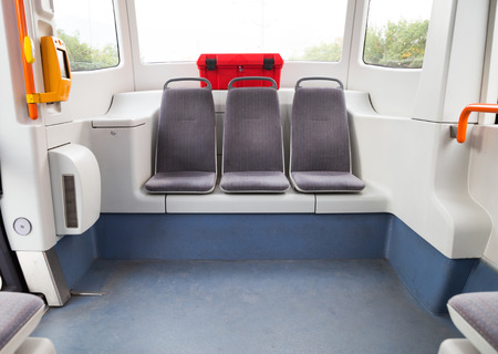 streetcar: Interior of a modern tram or streetcar showing three empty seats at the back of the vehicle below panoramic windows. Stock Photo