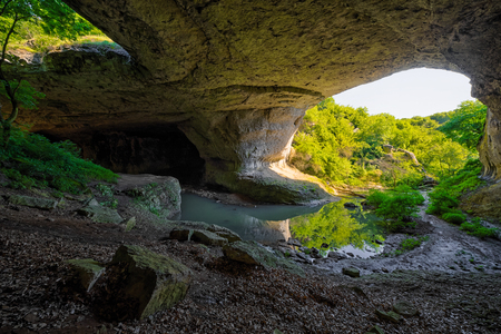 most: Bridge of God (Boji most) is a natural phenomenon located in a karst area about 15 km north from town of Vratsa, Bulgaria. One of the most attractive karst regions in Bulgaria. Stock Photo