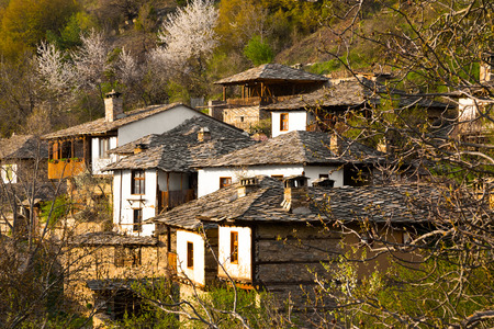 house with style: Scenic view of the mountainous historical village of Leshten with its traditional regional houses in the Province of Blagoevgrad in Bulgaria