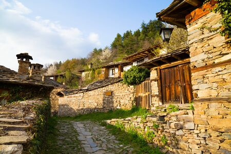 real renaissance: Stone walls and terraces of the historic traditional houses in the village of Leshten, Bulgaria in the Rhodope Mountains, a popular tourism attraction