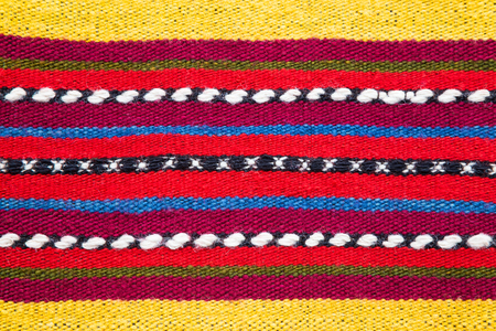 hand woven: Bulgarian hand woven woollen rug with a bright multicolored striped pattern and white accents in a full frame background texture Stock Photo