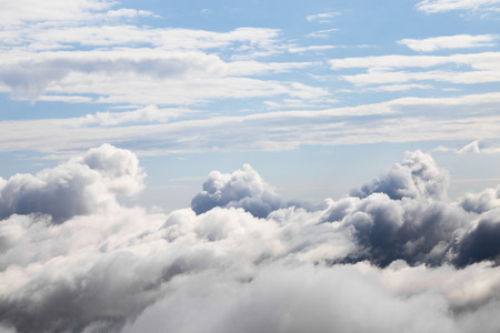 cloud formations: Cloudscape with an aerial view over the white cumulus cloud formations under a blue sky