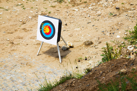 high angle view: Crossbow bolts or arrows in a portable outdoor target at a shooting range in a high angle view