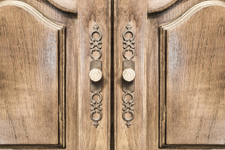 Stylish brass door handles on a hardwood cabinet or closet with stylish brass door handles on a hardwood cabinet or closet with ornate escutcheons and raised panels planetlyrics Image collections