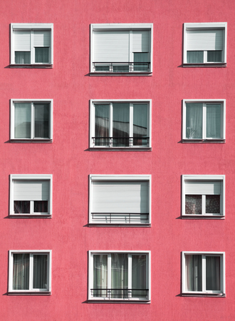 urban housing: Exterior of modern light red urban housing block with apartments Stock Photo