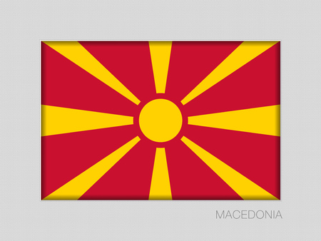 Flag of Macedonia, national ensign aspect ratio 2 to 3 on gray cardboard.