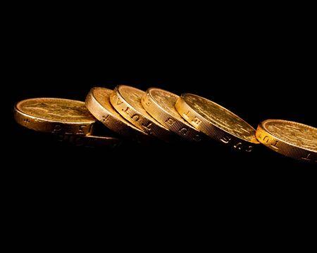 pound coins on a black background Stock Photo