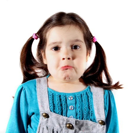 young girl upset and about to cry photo