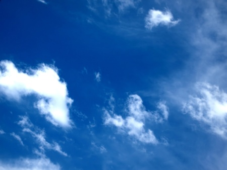 Blue sky with white whispy clouds          Stock Photo