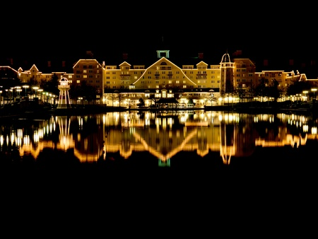 Disneyland Paris, France, March 6th 2012, The Newport Bay Club hotel is illuminated and reflects in the lake at its entrance