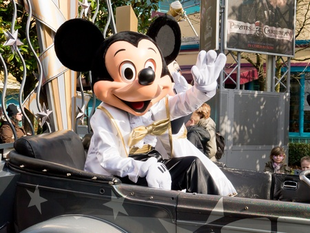 Disneyland Paris, March 06 2012, Mickey Mouse waves from a car during the Cars and Stars Parade at Disney studios park Paris