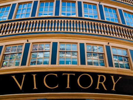 HMS Victory, March 2012, Portsmouth, England, The rear of HMS victory with modern warships reflecting in her windows