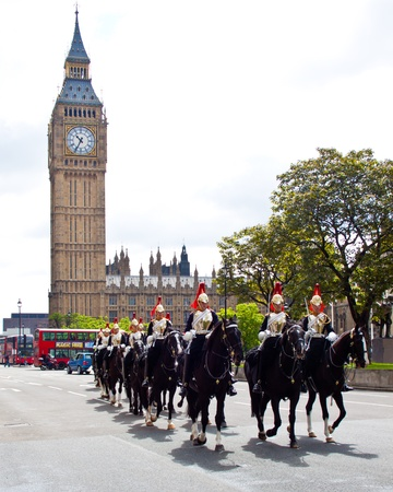 Household Cavalry guards in front of Westminster Palace and Big ben, London, UK, June 2012