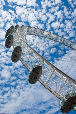London eye against blue sky and white clouds, London, Uk, June 2012