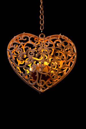 bougie coeur: coeur sur une chaîne avec une bougie à l'intérieur Banque d'images