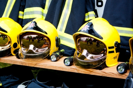 rescue service: fire and rescue service helmets on a bench Editorial